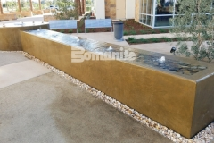 This stunning water feature was installed using Bomanite integrally colored concrete that was smooth trowel finished and perfectly complements the tranquil and therapeutic design aesthetic.
