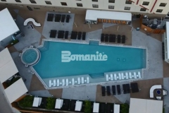 This pool deck design was installed by Bomanite of Tulsa, Inc. and features Bomanite Alloy decorative concrete that is comprised of various geometric shapes and colored with Bomanite Nickel Gray and Gobi Desert coloring to create contrast and complement the design aesthetic at the Tulsa Hard Rock Hotel & Casino.