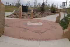 Bomanite Sandscape Texture decorative concrete offers consistent texture and durability and is featured throughout the hardscape surfaces at Centennial Center Park and was perfect to provide a backdrop to display the sandblasted graphics and text throughout the park.