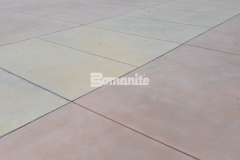 I love the variation in color that was incorporated into this Bomanite Sandscape Texture decorative concrete because it adds a distinctive look to the hardscape while maintaining a connection between multiple exterior spaces.