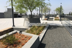 A Bomanite Exposed Aggregate Sandscape Texture finish was used to create these lineal planters and circular tree planters, adding beautiful textural detail that complements landscape design elements on this rooftop terrace and garden.