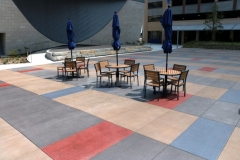 Sandscape Texture decorative concrete by Bomanite was installed here and stained using both vibrant and subtle shades of Bomanite Con-Color to create visual interest with the unique pattern detail while maintaining a cohesive design feel throughout the space.