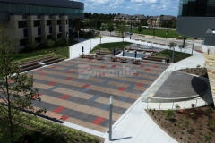 I love the vivid pops of color that were incorporated into this Bomanite Sandscape Texture decorative concrete because the beautiful stain pattern adds a unique and aesthetically pleasing design feel to this outdoor gathering space.