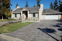 Our colleague Heritage Bomanite transformed the hardscape surfaces at this Fresno, California residence by utilizing Bomanite Imprint Systems to create the decorative concrete driveway, walkways, and back patio, all of which feature the English Sidewalk Slate Bomacron pattern to complement the cozy cobblestone cottage design.