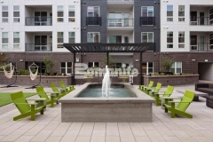 This water feature was created with board-formed decorative concrete to create a wood grain imprint that is extremely well-suited as a finish material and adds a modern and rustic elegance that enhances the relaxing atmosphere in the COLAB Co-Housing stylish student living community.