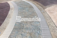 This stunning hardscape at Canobie Lake Park was created using Bomanite Imprint Systems and includes serpentine drains that can infiltrate storm water and minimize runoff while accentuating the decorative concrete decking at the Castaway Island water feature.