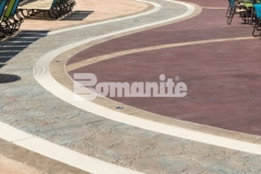 This stamped concrete decking features Bomanite Imprint Systems, including multiple Bomacron patterns that integrate perfectly to add beautiful contrast and dimensional detail throughout the Castaway Island water feature in Canobie Lake Park.