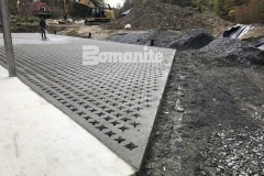 This decorative hardscape surface features Bomanite Grasscrete pervious concrete that was installed here to create access for large delivery vehicles while providing a long-term solution for stormwater management.